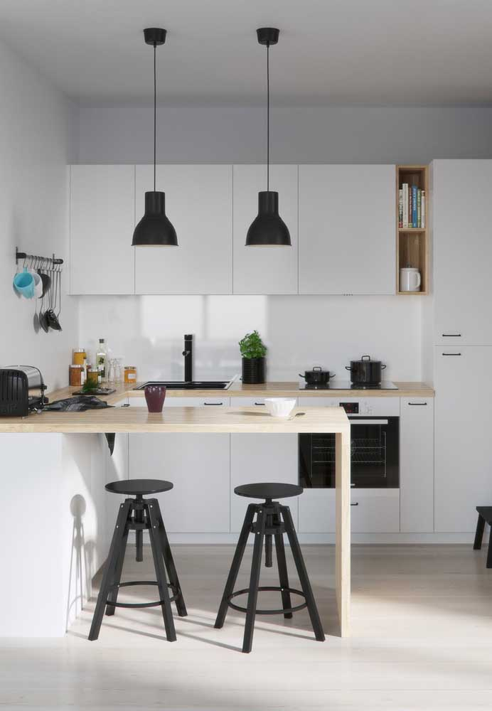 22. Simple small American kitchen in light tones opposite some dots in black.