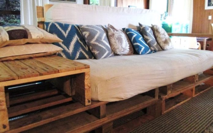 22. Use wood and make a nightstand for the pallet sofa