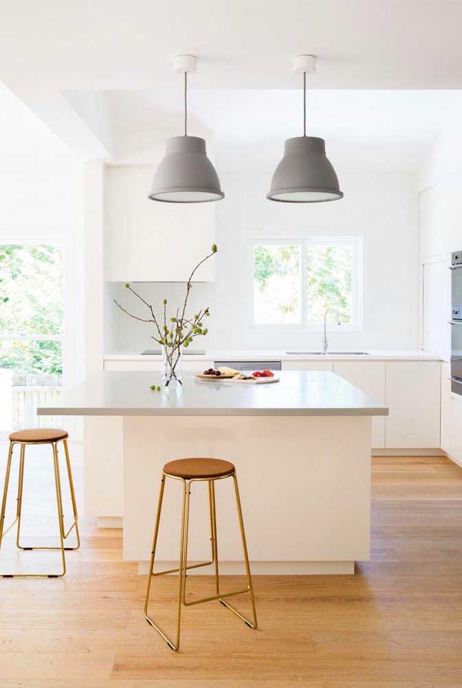 28. Small kitchen with island;the entry of natural light and light tones increase the feeling of space in the room.