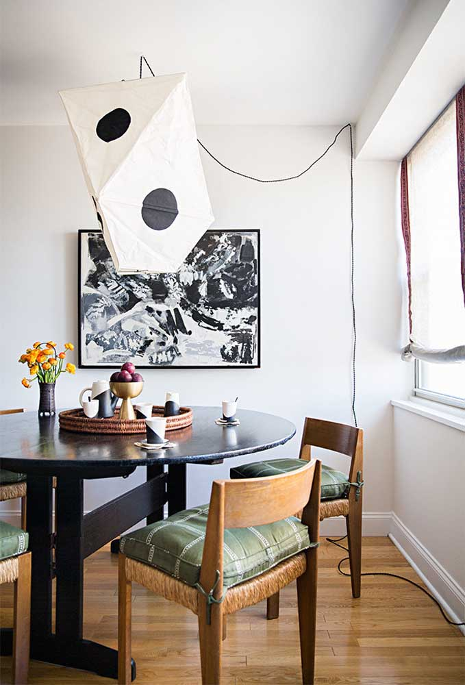 29. The highlight of this dining room is the lamp made of paper.