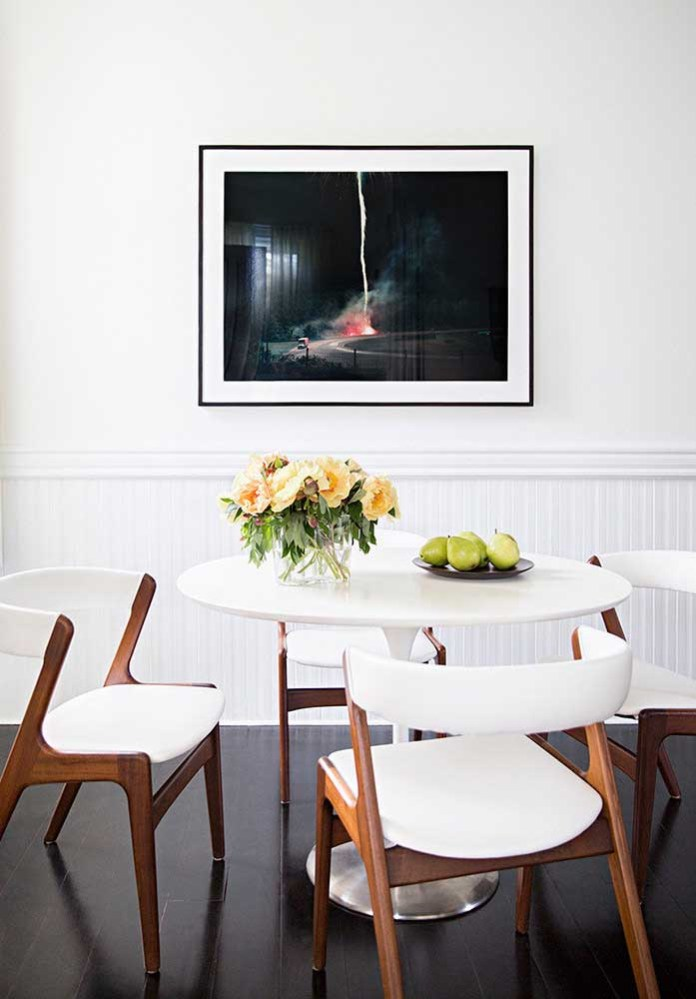 30. Small, simple dining room decor. The white and wood tones are the highlight here.