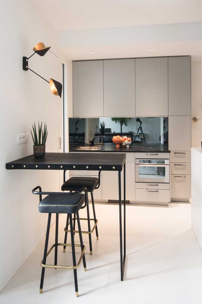 37. In this small American kitchen, the furniture fits into a single wall; highlight the stylish iron counter.