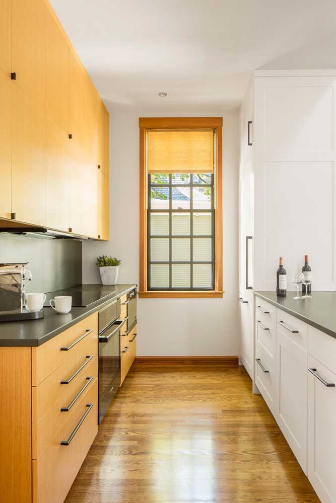 43. Small hallway-style kitchen with custom-made furniture on both sides of the room.