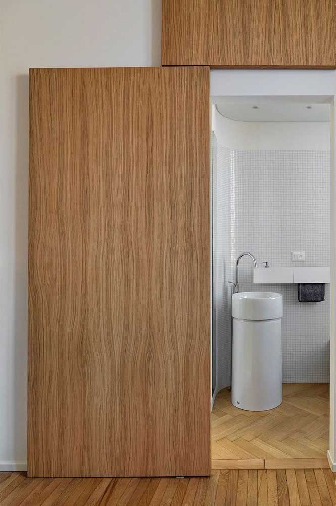 02 - Sliding door to the modern bathroom. The wood provides a clean and neutral environment.