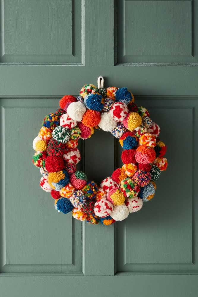 35. Another Christmas wreath inspiration made with wool pompoms; only this time more colorful and fun.