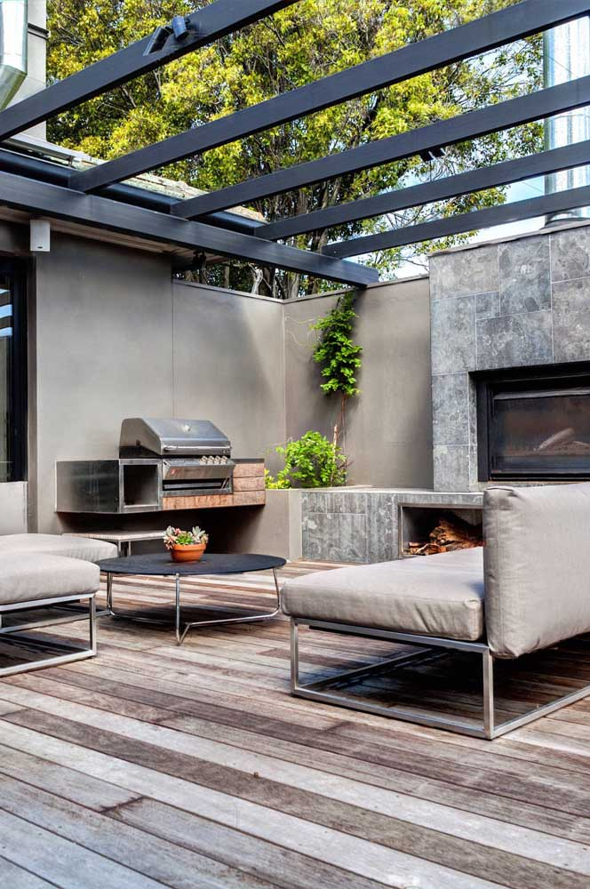 38. Leisure area with barbecue in cement finish modern design.