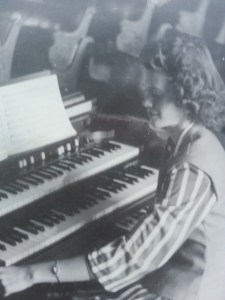 Mom playing at church.  The organ no less, with two keyboards and foot pedals.