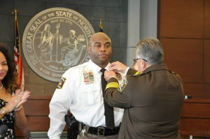 Durham County Sheriff Michael Andrews promotes 14 deputies.