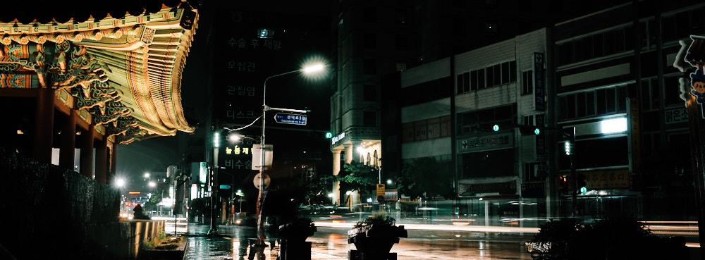 Gwandeokjeong with traffic on a rainy night