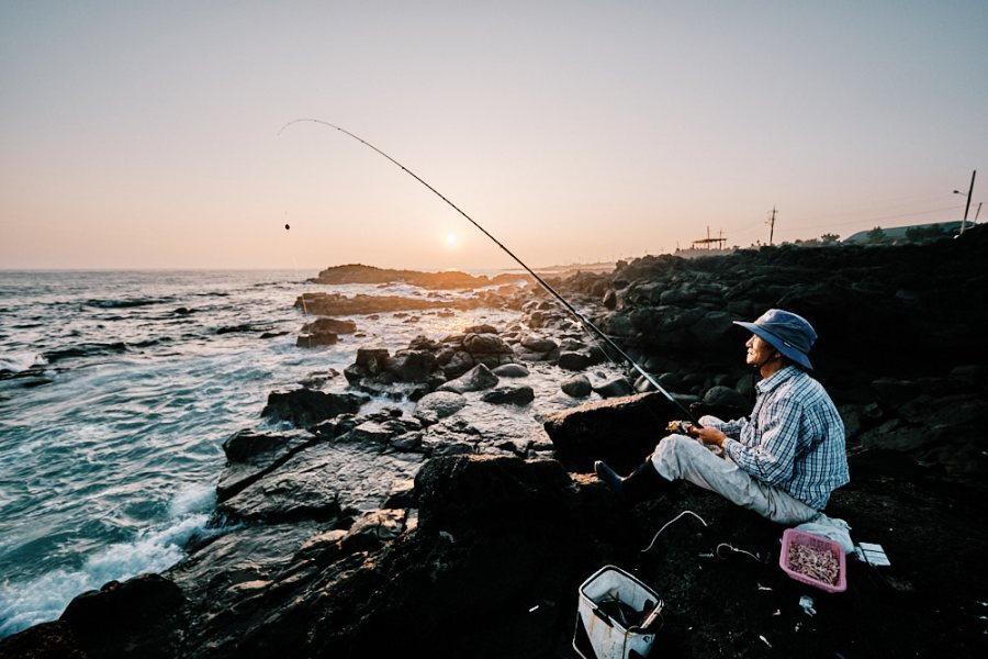Jeju Island Rock Fishing at Sunset