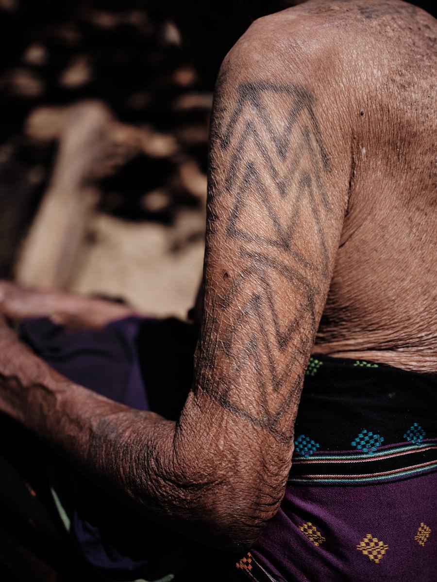 Guga Naga Arm Tattoo