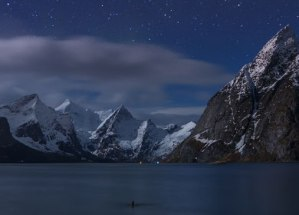 lake surrounded by snowy mountains