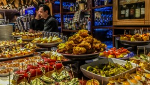 Resist your urge to taste all pintxos in one bar but do it like the locals: go from bar to bar, tasting one or two before moving on