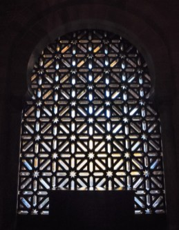 The geometrical patterns of the latticed windows play with the sunlight