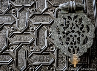 The original great doors of the Moorish Puerta del Perdón are made from larchwood covered with bronze