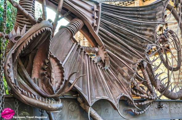 "The dragon has bat's wings, a scaly body, great fangs and a sinuous tongue, that hisses ""keep out"" to strangers"