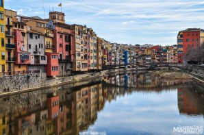The colourful houses stand shoulder by shoulder looking out to the Onyar river