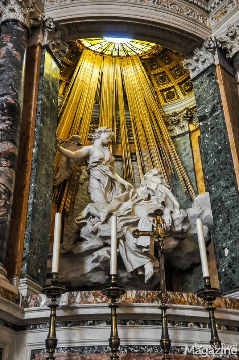 "Bernini's statue ""Ecstasy of St. Teresa"" depicts the moment when, as St. Teresa writes in her biography, she ""..had a vision of an angel piercing her heart"""