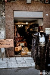 On Vittorio Emanuele you might find a couple of vintage boutiques, book stores and artisans