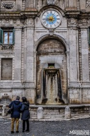 Fountain and public clock at Piazza del Mercato