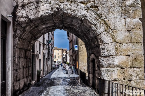 The Arch of Drusus from 23 AD marks the ancient entrance into the Roman forum, now Piazza del Mercato