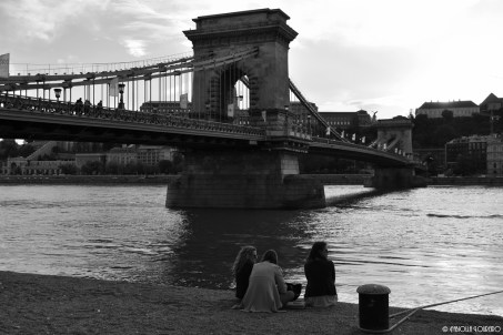 Friends relaxing at sunset close to Chain Bridge