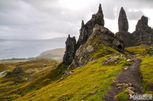 Misty mountains and a glittering sea make a contrasted backdrop to the black monoliths of Storr.