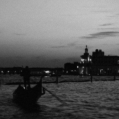 Gondolier working at sunset. Sunsets in Venice can be a real experience, and if you are inside a Gondola, the thrill will be even better