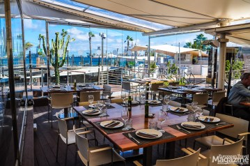 Even when it's windy or rainy weather, you can sit inside the restaurant and enjoy the views of the port