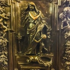 The huge bronze doors are worthy of the famous Gates of Paradise of the Baptistry of Florence