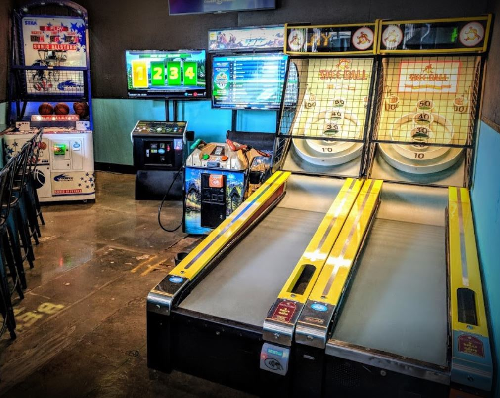 Game room coin-operated games at a bar