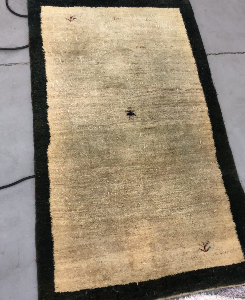 Oriental Rug before being cleaned by EA Restoration