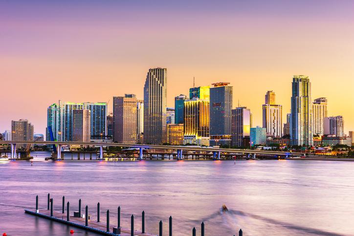 Miami, FL skyline at dusk.