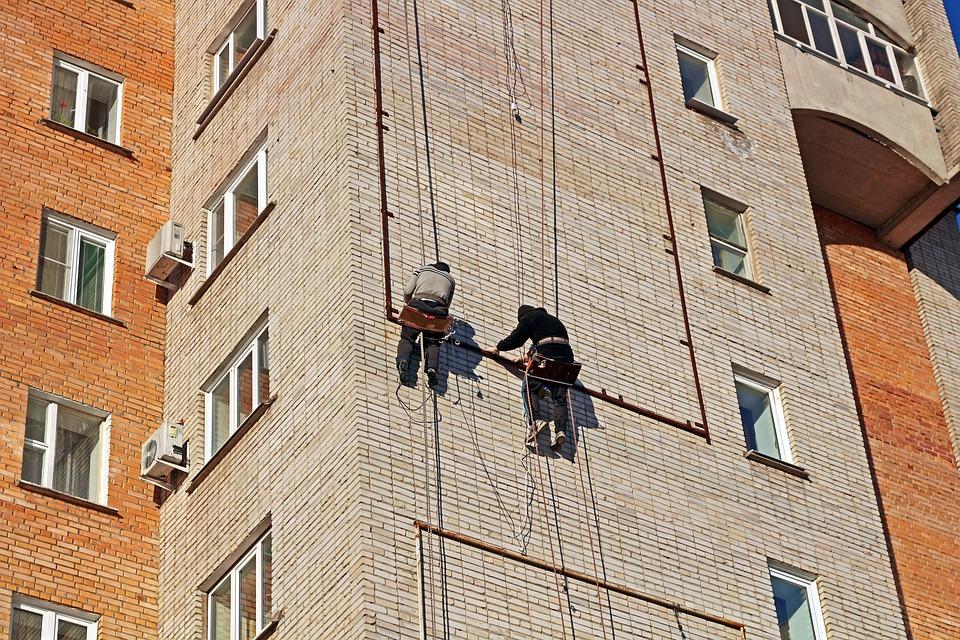 men climbing building