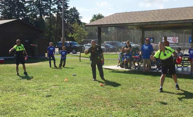 NSPD plays disc golf with local kids