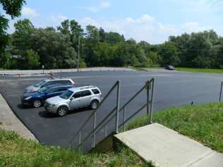 View of the newly paved Creekside public parking lot from the library lot. (photo by Jason Emerson)