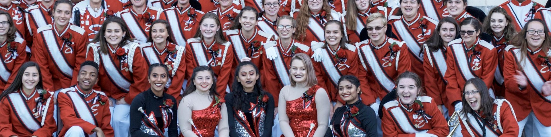Easton Band Members Posing in Front of a Brick Wall