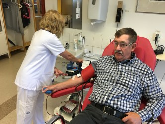 Dad's a pro - this is his 80th time donating blood.