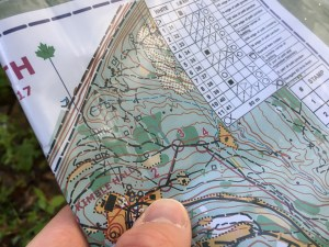 Thumbing a map.