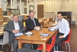 Cllr Bassam Mahfouz, Graham Raine and Charles Craft with donated dining furniture at the Furnish shop in Sheperds Bush. Residents are able to buy discounted donated furniture at this store as part of the Re-use service.