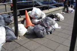 Bags of rubbish left of the street