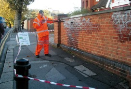 graffiti being cleaned off wall