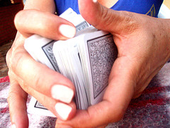 hands shuffling a deck of cards