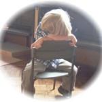 boy on chair, hiding face
