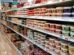 long shelf of containers at grocery store