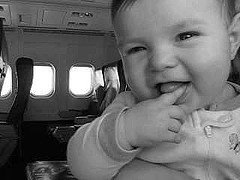 smiling baby in airplane