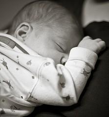 baby sleeping on parent's shoulder