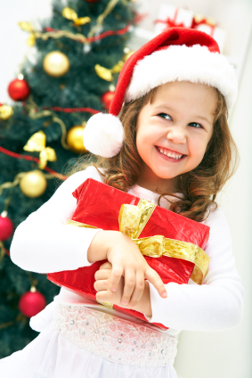girl smiling and holding Christmas gift