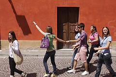 group of happy teenagers walking down street