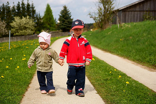 two little boys walking and holding hands
